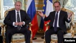 Франция президенти Франсуа Олланд ва Россия президенти Владимир Путин.