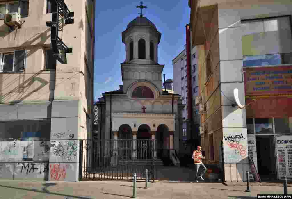 St. John the New Orthodox Church in Bucharest on October 30, 2017, nestled between modern buildings.