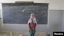 Сириялык окуучу кыз.