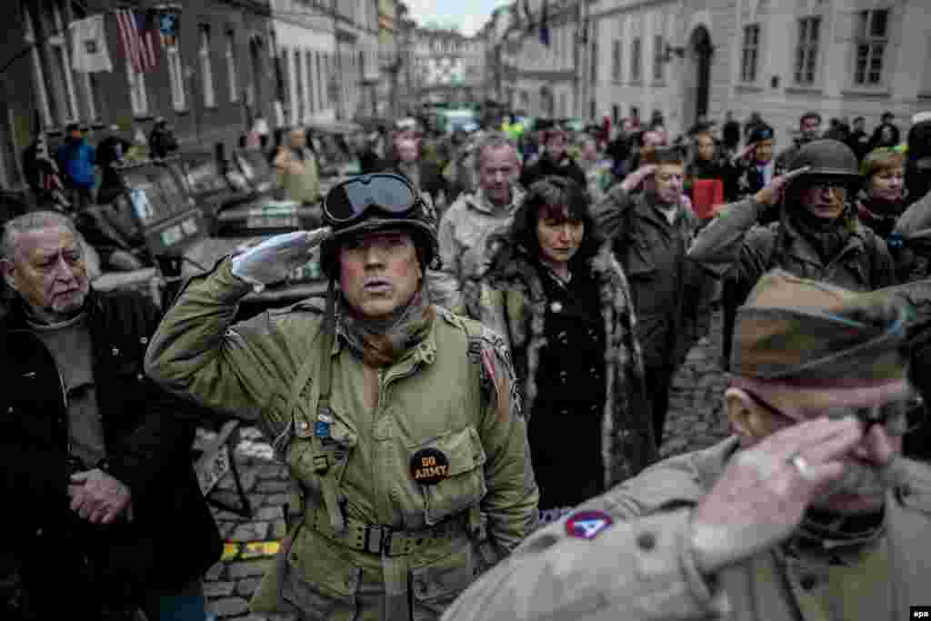 History enthusiasts wearing WWII U.S. Army uniforms salute as the national anthem of the United States is played during the Convoy Of Liberty commemoration event in Prague. The Convoy Of Liberty commemorates the moments in 1945 when the western part of the country was liberated from Nazi oppression by the U.S. Army. (epa/Martin Divisek)