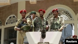 Military policemen stood guard outside a ministry building in Sanaa in early June.