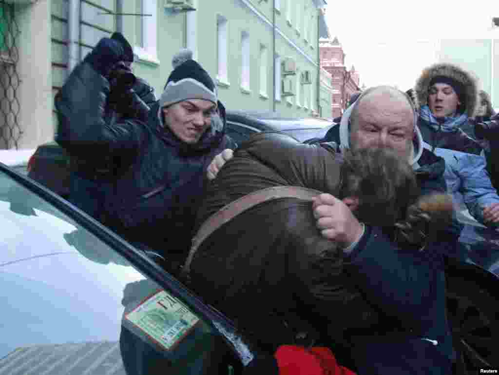 Unknown assailants attack a gay-rights activist during a protest outside the State Duma in Moscow. The State Duma is to consider a federal bill that makes the dissemination of information about Russia's gay community to minors punishable by fines of up to $16,000. (Reuters/Sergei Karpukhin)