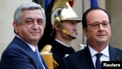France -- Armenian President Serzh Sarkisian (L) is greeted by French President Francois Hollande upon his arrival at the Elysee Palace in Paris, March 8, 2017