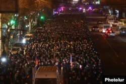 Armenian opposition supporters take part in a torchlight procession in Yerevan on December 18.