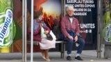 Bosnia and Herzegovina, Sarajevo, people sitting on a tram stop without protective masks