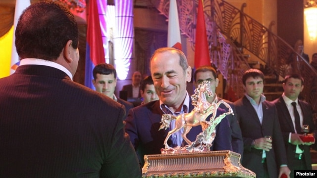 Armenia - Former President Robert Kocharian receives an award from National Olympic Committee Chairman Gagik Tsarukian, near Yerevan, 26Dec2013.