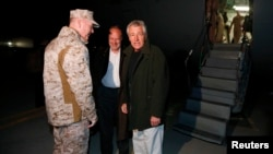U.S. Secretary of Defense Chuck Hagel (right) is greeted by U.S. Ambassador to Afghanistan James Cunningham (center) and General Joseph Dunford, commander of the International Security Assistance Force upon Hagel's arrival in Kabul on March 8.