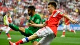 Russian midfielder Aleksandr Golovin (right) and Saudi Arabian defender Muhammad Al-Breik vie for the ball during their opening World Cup match, which Russia won 5-0 on June 14.