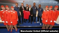 Manchester United players Ryan Giggs, Rio Ferdinand, and Patrice Evra were on hand with their manager David Moyes for the unveiling of Aeroflot as the club's official carrier.