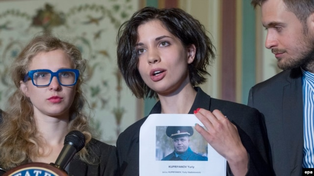 Nadezhda Tolokonnikova (center) -- with fellow Pussy Riot member, Maria Alyokhina (left), and husband Pyotr Verzilov (right) -- holds a list of names of individuals they believe should be sanctioned under the Magnitsky Act, in Washington on May 6.