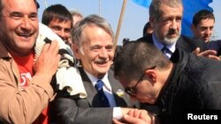 Crimean Tatars greet and escort Mustafa Dzhemilev (center) before attempting to pass a checkpoint connecting Ukraine's Kherson region and Crimea near the city of Armyansk on May 3.