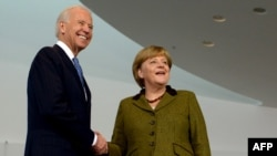 German Chancellor Angela Merkel (right) welcomes U.S. Vice President Joe Biden at the Chancellery in Berlin on February 1.