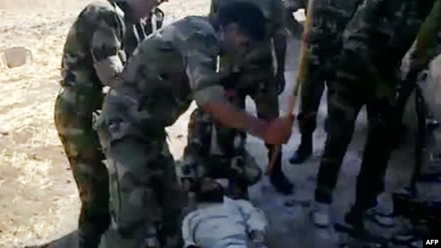 "A video shows what is described by antiregime activists as the torture by government forces of a ""martyr"" named Louai al-Amer in Houla in Homs last year."