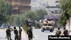 AFGHANISTAN -- Afghan National Army (ANA) soldiers arrive at the site of gunfire and attack in Jalalabad city, Afghanistan July 11, 2018.