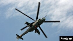 An Armenian Mi-24 combat helicopter flies near Yerevan. (file photo)