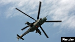 Armenia - An Armenian Mi-24 combat helicopter flies near Yerevan, 11Jun2014.
