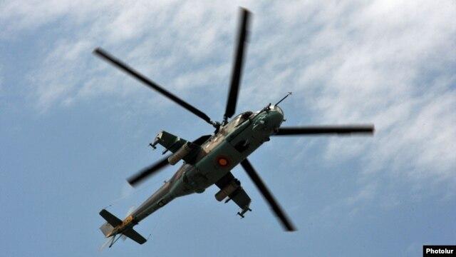Armenia - An Armenian Mi-24 combat helicopter flies near Yerevan, 11Jun2014.