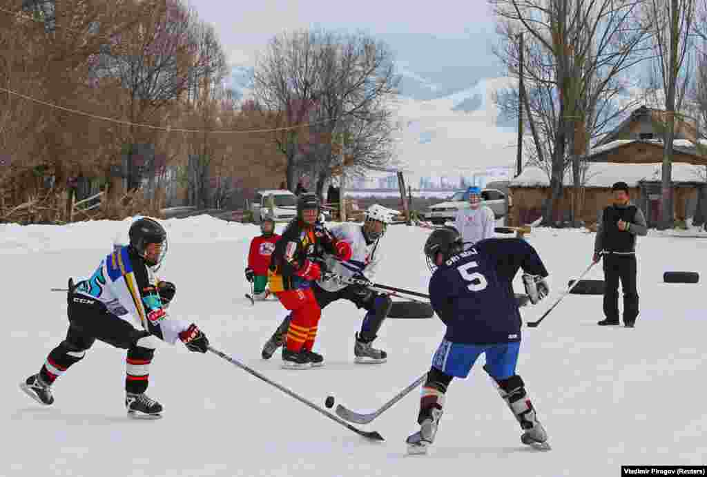 KYRGYZSTAN -- Young hockey players are seen in action during a training match between Kyrgyzstan's first female hockey team and the male team of the Karakol lyceum, in the village of Otradnoye, Kyrgyzstan February 4, 2020.