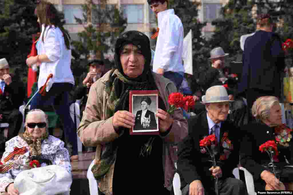 A woman attends the celebrations in the Daghestani capital, Makhachkala.