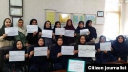 "Iranian teachers in many parts of the country refused to go to their classes for the second day in a row, in protest to their situation on Monday, October 15, 2018. One placard says: ""A teacher's place is not in prison""."