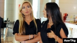 Azerbaijani President Ilham Aliyev's daughters, Arzu and Leyla, at Park Bulvar in Baku in June 2010.