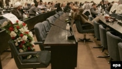 Flowers in Iraq's parliament on the seat of a deputy killed in a bomb attack during a special session in Baghdad in April 2007