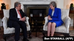 Britain's Prime Minister Theresa May (R) talks with United Nations Secretary-General, Antonio Guterres, during their meeting inside 10 Downing Street in central London on May 2, 2018