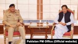 FILE: Pakistani Prime Minister Imran Khan and army chief General Qamar Javed Bajwa.