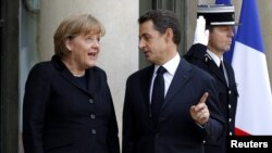 French President Nicolas Sarkozy and German Chancellor Angela Merkel say European leaders are determined to secure euro zone.