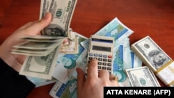 The street value of the rial to the dollar has reportedly hit a record low (file photo).