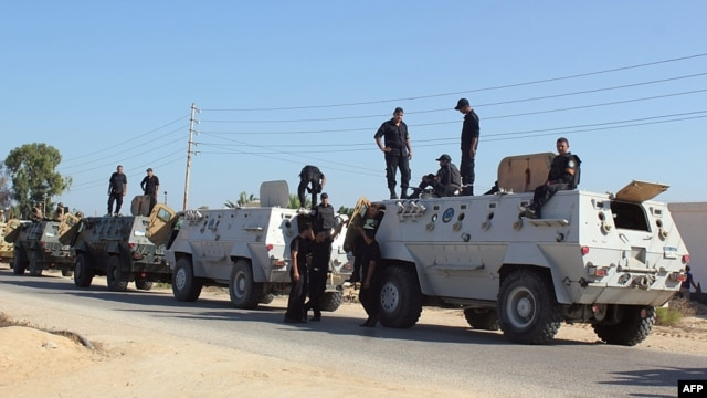 Egyptian security forces stand by their armored personnel carriers ahead of a military operation in the northern Sinai Peninsula on August 8.
