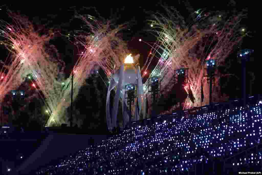 Closing Ceremony: Fireworks explode over the Olympic flame during the closing ceremony of the 2018 Winter Olympics in Pyeongchang, South Korea, Sunday, February 25, 2018. (AP Photo/Michael Probst)