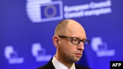 Ukrainian Prime Minister Arseniy Yatsenyuk talks to the press after attending meetings at the European Council in Brussels on March 19.