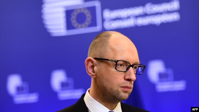 Ukrainian Prime Minister Arseniy Yatsenyuk told EU leaders in Brussels that Moscow was aiming to divide them.