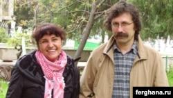 Photojournalist Umida Ahmedova (left) with Oleg Karpov in an undated photo