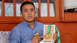 Afghan MMA Champ To Auction Medals For Attack Victims' Families