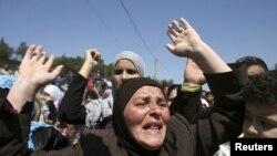 Сирия президенті Башар әл-Асадқа қарсы ұран айтып тұрған әйел. 16 мамыр 2011 жыл.