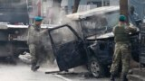 Turkish soldiers take pictures of a vehicle at the site of a suicide attack in Kabul. (file photo)