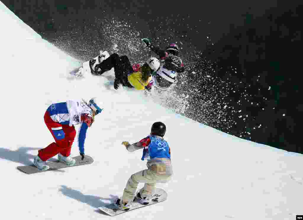 Michela Moioli of Italy (in black) collides with Alexandra Jekova of Bulgaria (in yellow) in front of Chloe Trespeuch of France (white) and Faye Gulini of the United States (blue) during the women's snowboard cross final at Rosa Khutor Extreme Park. (EPA/Sergei Ilnitsky)