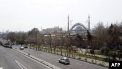 A photo shows an almost empty road in the Iranian capital Tehran, March 13, 2020