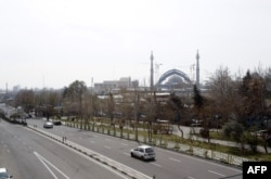 A photo shows an almost emply road in Tehran on March 13.