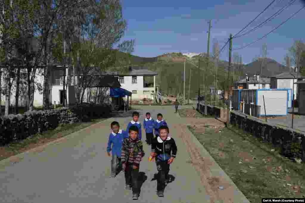 Children return home from school. The local schools don't offer a complete secondary education, and many children are sent away to boarding school after age 13.