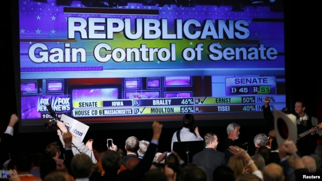 Republican supporters cheer as a giant TV screen displays the results of the Senate race in the U.S. midterm elections in Denver, Colorado, on November 4.