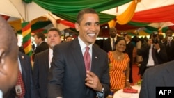 U.S. President Barack Obama greets residents during breakfast at the Presidential Castle in Accra.