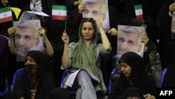 Supporters hold portraits of presidential candidate and lead nuclear negotiator Said Jalili during a campaign rally in Tehran on May 24.
