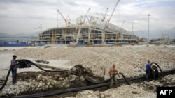 The construction of facilities for the 2014 Winter Olympics in Sochi, such as Olympic Stadium, has been dogged by huge cost overruns. (file photo)