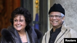 Muhammad Yunus (right), pictured here on a visit to France in 2010