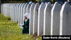 Bosnia-Herzegovina, A woman mourns among graves in Memorial Center Potocari, near Srebenica, Bosnia and Herzegovina July 11, 2015