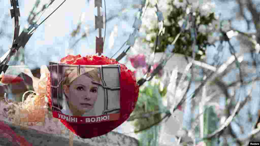 "A sign showing Tymoshenko with the words ""Freedom to Ukraine,"" outside the prison where she is being held in Kharkiv."