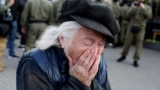 Belarus - An elderly woman reacts as she attends a rally to protest against the presidential election results in Minsk, 19sep2020